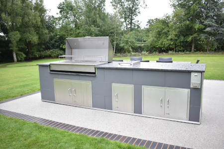 Que Fresco stainless steel BBQ grill in an outdoor kitchen